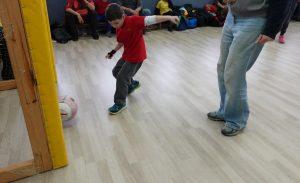 kid plays football
